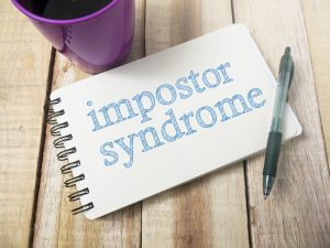 Note pad that says Imposter Syndrome